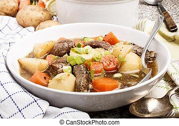irish stew in a deep white plate