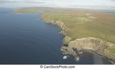 Irish world famous tourist attraction in County Clare. The Cliffs of Moher sunset West coast of Ireland. Epic Irish Landscape and Seascape along the wild atlantic way.Scenic nature from Ireland.
