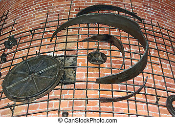 Decorative iron works on weathered brick wall
