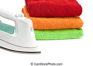 Iron and stacked colorful towels.
