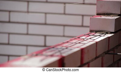 Iron bars for brickwork Bricklaying process
