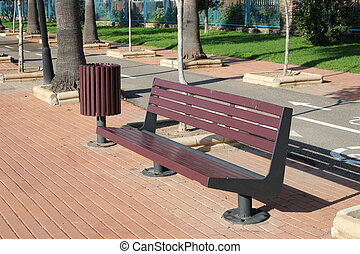 Iron bench with wooden seat