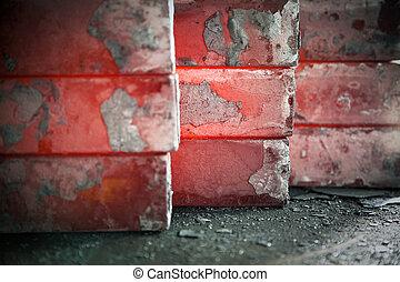 iron blocks - piles of hot iron blocks in foundry. Narrow...