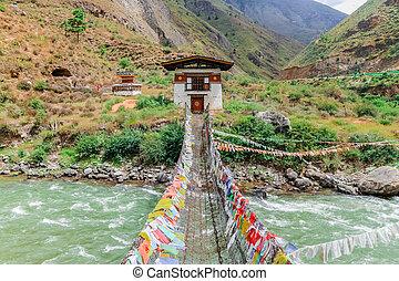 Iron Bridge of Tamchog Lhakhang Monastery, Paro River, Bhutan. Located along the Paro-Thimphu highway across the Paro River.
