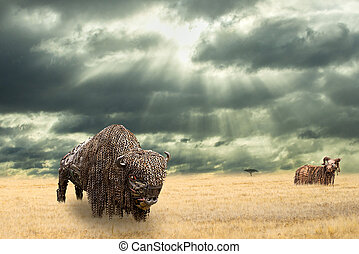 Iron buffalo made of iron scrap walking in dry prairie watched by a wild ram from distance. Open plain landscape with Amercian bison