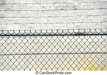 iron chain link fence in front of the wall