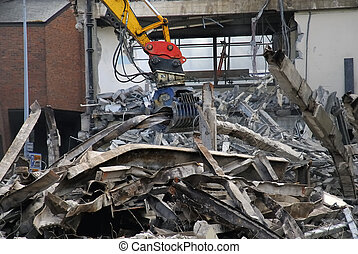 Iron Claws - Demolition claws grabbing a large steel girder