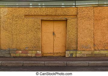 Iron door in the concrete wall