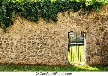 iron door in the stone wall