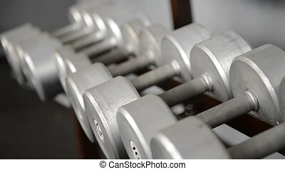 iron dumbbells lie in a row at the gym - Iron dumbbells lie ...