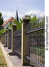 iron fence with sandstone pillars