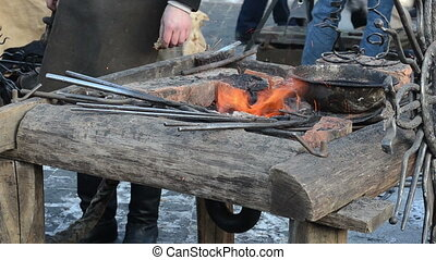 iron fire ember heat - Iron steel rod heat glow in fire...