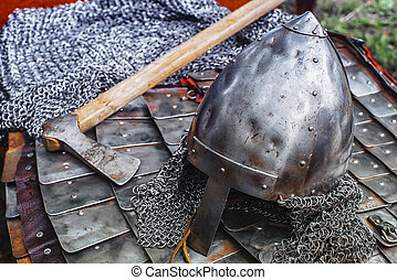 Iron helmet in armor and ax