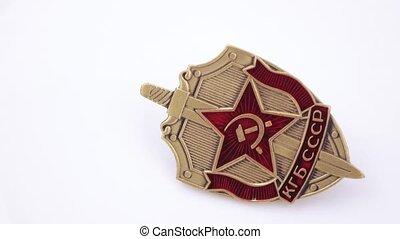 Iron KGB badge on white - Numismatic metal with enamel badge...