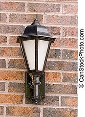 Iron Lamp on Brick Wall