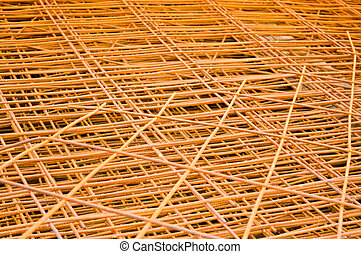 Iron metal braided rusty yellow reinforcing welded industrial construction mesh from reinforcement and corrugated wire. Texture, background
