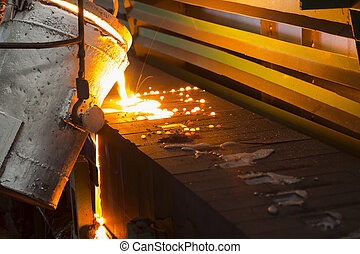 Iron molten metal pouring in sand mold ;