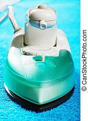Iron over blue cloth closeup