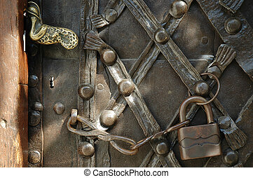 Iron padlock and chain on old door