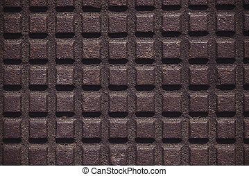 Iron plate with a checkered pattern.