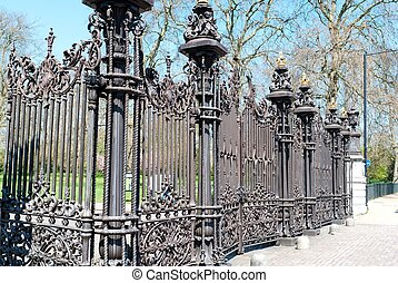 Iron railing around small park garden in London, England