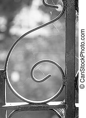 Iron Scroll Work - Details of iron scroll work in black and...