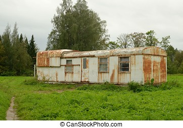 Iron trailer in a field.