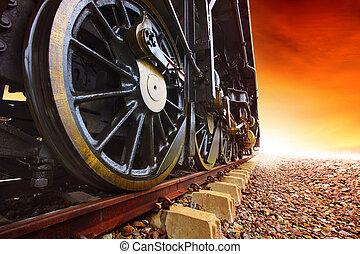 iron wheels of stream engine locomotive train on railways track