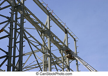 Iron Worker 1 - an iron worker works on a structure with the...