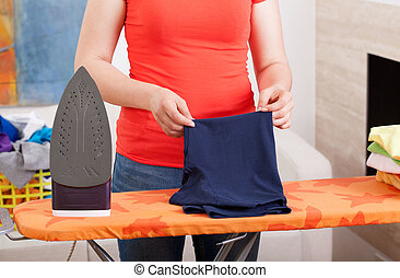 Ironing clothes at home