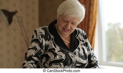 Ironing Old Woman at the Room