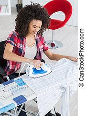 ironing the clothing