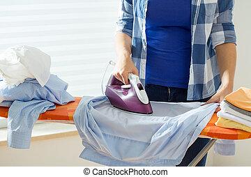 Ironing the shirt