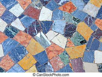 Irregular colourful mosaic pattern with different sorts of marble found on an antique floor in Rome, abstract background