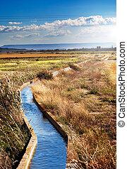 irrigation channel - Rural landscape with irrigation channel...