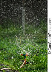 Irrigation - Rotating irrigation system throwing water drops...