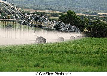 Irrigation Sprinklers - Irrigation sprinklers watering a...