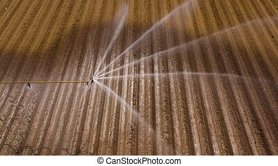 Irrigation system on agricultural land. - aerial view Center...