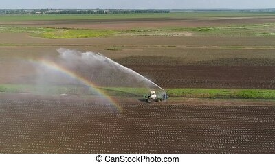 Irrigation system on agricultural land. - Aerial view crop...