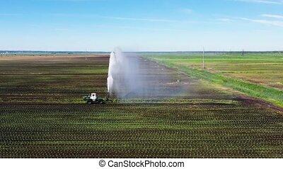 Irrigation system on agricultural land. - Crop irrigation...