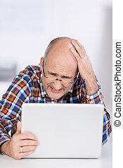 Irritated Businessman Looking At Laptop