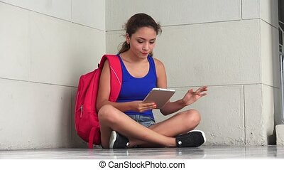 Irritated College Student Reading Tablet