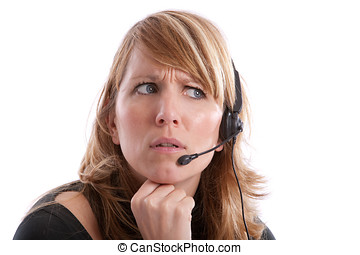 Irritated receptionist - Young pretty receptionist looking ...