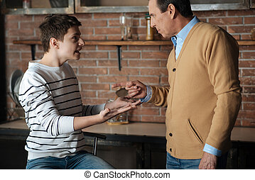 Irritated teenager shouting at his father