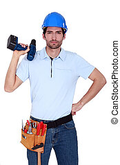 Irritated tradesman holding a battery-powered screwdriver