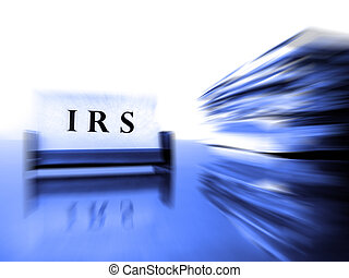 IRS Card on desck with tax files zoomed showing progress or action