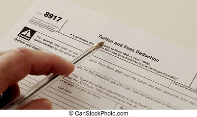 An anonymous person reading the Internal Revenue Service form 8917 which is used for and income tax reduction for tuition and education fees that have been paid by the claimant.