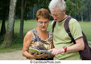 Is this the right way? -4 - Active senior couple on a hike.