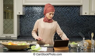 islam woman cut vegetables watching halal dish recipe - ...