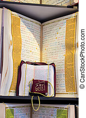 Islamic Holy Book Quran  on the market shelf